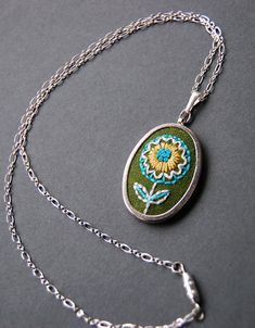 Embroidered Pendant- so pretty!  I may have to start a craft board.  :)