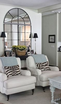 White sitting area with light blue and animal print pillows