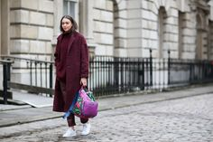 Choose one jewel tone and maximize its impact with easy trainers and a brightly colored backpack. Practicality doesn't have to be boring. #refinery29 http://www.refinery29.com/2015/02/82710/london-fashion-week-2015-street-style#slide-1