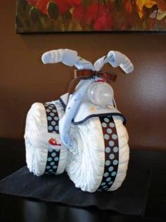 Baby shower gift.  The wheels are diapers!