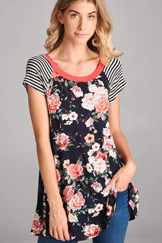 Black body with colorful fall floral print. Coral neckline and black/white stripe sleeves.  Looks really cute paired under our Cable Knit Sweaters!