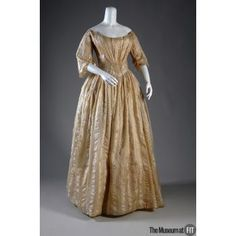 As the description of this 1845 dress on the FIT Museum site explains, there was a paradox in the fashion of this period: the ideal woman was much plumper than is considered stylish today, but had a very small waist. The pointed bodice helped create the illusion, as of course did lacing one's corset tightly!