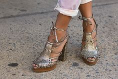 Shoe Stalking: The Best Heels, Boots, and (Yes, Even) Flats at NYFW: The most ladylike of cap-toe heels seen walking out of Oscar de la Renta.: These silver cap-toe booties have just the right amount of polish and edge.  : We spied a unique pair of lace-up metallic heels taking the streets outside the tent.
