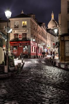 "The rainy day turned to night in Paris and the streets of Montmartre turned to black. See the whole story and buy a print on my blog at: <a href=""http://www.batteredluggage.com/2012/le-consulat/"">http://www.batteredluggage.com/2012/le-consulat/</a> This image is released under Creative Commons, Non-Commercial. For Commercial Use please email me at licensing@batteredluggage.com Travel Blog - <a href=""http://www.batteredluggage.com/"">www.batteredluggage.com</a> Twitter - <a href=""http://www..."