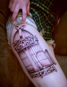 Birdcage thigh tattoo