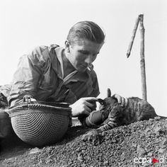 Here is the picture of Doctor Patrice de Carfort petting a cat on his way to serve as a medic on Isabelle hill, your argument is invalid. Dien Bien Phu, 1954.