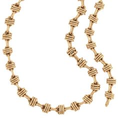 Gold Link Necklace/Bracelet Combination, Bulgari  18 kt., composed of polished gold oval links wrapped with triple oval links, joined by oval links, signed Bulgari, approximately 105.2 dwt. Lengths 22 3/4, 15 1/4 and 7 1/2 inches.