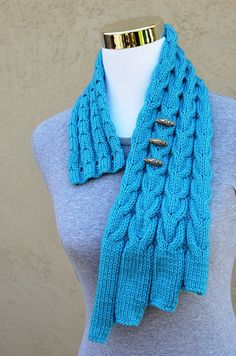 """This is a KNITTING PATTERN only, not a finished item. Your knitting pattern will be emailed to you as a PDF download asap after payment is received.  Skills needed: Knit & purl sts Increasing & decreasing cable sts  Size; Adult (Length: 32.5 in/ 82.5 cm, Wide: Approx. 5.5 in/ 14 cm)  Gauge: 20 sts x 25 rows = 4"""" x 4"""" in Stocking sts  Needles & materials: US7/ UK7/ 4.5 mm needles, cable needle, yarn needle, three buttons  Yarn: Aran or Category 4 medium worsted weight yarn approx. 186 yds…"""