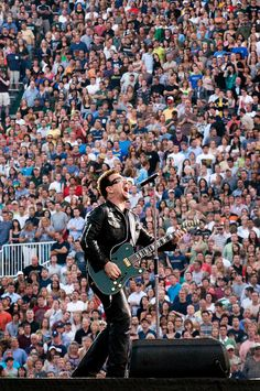 Bono & his beloved, green guitar. He gave it to a blind man in Nashville TN after allowing him on stage to play, All I Want Is You, during the U2360 tour! I know because I was there! ❤️❤️