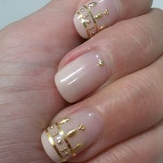 Now these are very interesting! I really like the pale neutral with the 3D look of the gold. Beautiful, understated design.