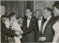 (Right, Jackie Robinson and Cab Calloway ).