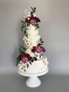 Country Wedding Cakes White with gold wedding cake adorned with Burgundy sugar flowers made with Satin Ice Blush Wedding Cakes, Burgundy Wedding Cake, Wedding Cake Fresh Flowers, Country Wedding Cakes, Elegant Wedding Cakes, Elegant Cakes, Gold Wedding, Wedding White, Summer Wedding
