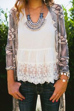 Lace shirt with jeans and a cardigan.