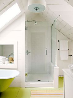 A Perfect Fit - Reconfiguring the master bath in this 1850s Cape Cod home gave the homeowners  a sunny and efficient space. A glass-enclosed shower preserves the room's openness, and tucking it under the eave allows room for storage and a wide walkway.