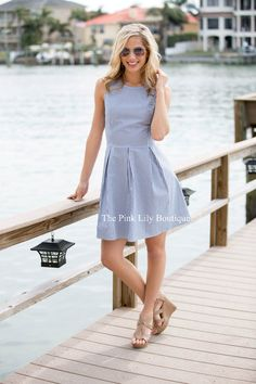 This dress is perfect for vacation or for a day out! We love the classic navy and white stripes and seersucker material. The adorable pleats and flattering cut of the dress make this even more of a summer must-have! (There's even a white zipper hidden in back!)