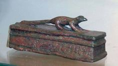 Egyptian Bronze Sarcophagus Lid with Mongoose Atop. Well defined details. Ca. 7127 - 332 BCE