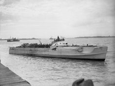 """The German Schnellboot (""""E-boat"""") S 204 flying a white flag of surrender at the coastal forces base HMS Beehive, Felixstowe, Suffolk (UK), on"""