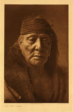 "Bear's Teeth – Arikara, 1908. Photogravure. Curtis Caption: ""A member of the Night order of the medicine fraternity."""