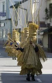 Men dressed as straw figures participate in a parade during the daffodil festival (Narzissenfest) in the small Austrian village of Bad Aussee. The daffodil festival takes place every year in Ausseerland to celebrate the start of springtime in this mountainous region of Austria.