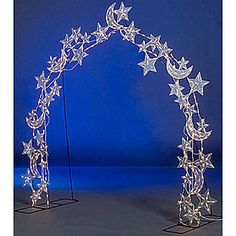 Our reusable Star and Moon Wire Arch features stunning stars and moons accented with 650 clear twinkle lights. Each star and moon arch measures 9 feet 9 inches high x 9 feet wide.