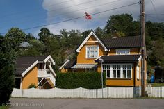 yellow wood house Sandefjord, Norway. Very typical color of a norwegian house. Other common colors include red, brown, white and blue.