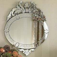Gorgeous mirror...this would look fantastic on a dark wall
