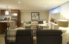 Basement Apartments from HGTV's Income Property: Streamlined Furniture Keeps a Space Open and Airy