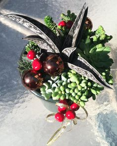 More Christmas succulents, this one with ribbon and artificial holly berries