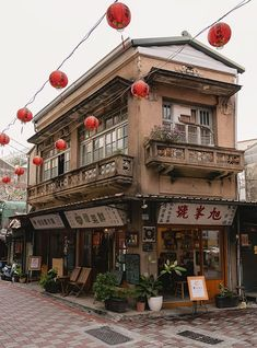 A popular old two storey corner building in Tainan with a fresh fruit juice cafe on the ground floor Japanese Buildings, Japanese Architecture, Old Buildings, Architecture Design, Building Aesthetic, City Aesthetic, Old Building Photography, Travel Photography, House Photography
