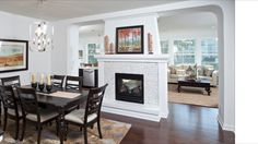 Double sided fireplace between living dining would - Fireplace between two rooms ...