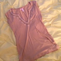 Pretty light brown top This top has satin around the neckline, multiple rhinestones and very pretty embroidering. Hollister Tops