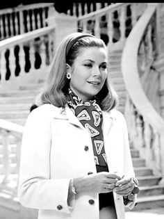 1967 Princess Grace of Monaco (wearing a creation of  Christian Dior) photographed by Howell Conant in front of the marble staircase at the Palais Princier