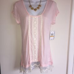 NWT cute as pie blush pink and cream top with Lace bottom and on the front of the top. Firm unless bundled. Thank you. Jolt Tops Blouses