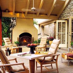 This perfect outdoor area is a peaceful oasis. I love the yellow tones and the fireplace makes it a year round haven.