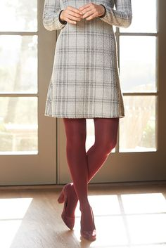 Love the look of the lightly textured dress over the burgundy tights and suede shoes.