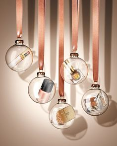 Beauty products in clear ornaments. Photo by still life photographer Ian Oliver Walsh.