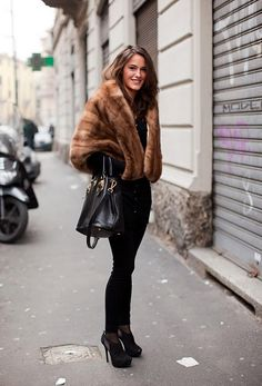 needing ideas on how to wear my new fur stole. it's pretty much identical to this one, so this is a good start.