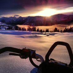 Snowmobiling sunset
