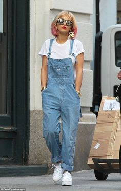 Girl with five colours in her hair: Singer Rita Ora ditched the tote and strolled through New York City wearing comfy denim dungarees