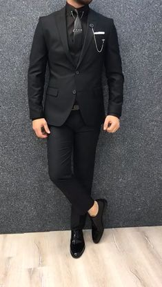 Name: GentWith Kenzie Black Slim Fit Wool Suit Collection: Fall – Winter 19/2020 Product: Slim-Fit Wool Suit Color Code: Black Size: 46-48-50-52-54-56 Suit Material: 70% wool, 30% polyester Machine Washable: No Fitting: Slim-fit Package Include: Jacket, Vest, Pants Only Gifts: Shirt, Chain and Neck Tie