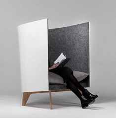 V1 Lounge Chair offers a private nook for lounging. A custom built floating table creates a small working place. http://vurni.com/v1-lounge-chair-desk/