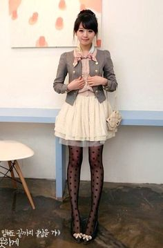 I love the ruffled a-line flowy white skirt, the polka dot tights, and the shoes with white bows.
