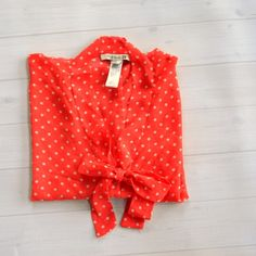 Coral Polka Dot Bow Front Blouse Small Adorable coral and white polka dot print top, size small. Open kimono sleeves and bodice with bow in the front. I tucked this top into a denim pencil skirt and it was SO cute! Definitely received lots of compliments on it ;) (the first picture shows the color a bit brighter than it is IRL) Forever 21 Tops Blouses