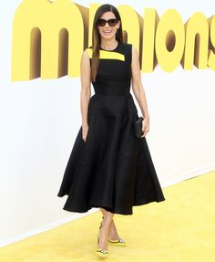 Sandy wore this Roksanda Illincic dress in black and yellow – the colors of the Minions – and she wore these absolutely AMAZING Minions-themed pumps by Rupert Sanderson. They are literally Minion-heels.