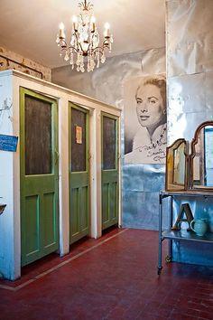 bathroom art idea: portraits of old hollywood/mexican actresses
