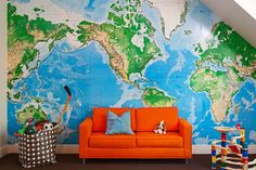 World wall map, orange sofa, Dwell studio storage bin.