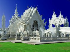 Slant View of the temple. This white temple is one's favorite tourist attraction of Chiangrai province of Thailand. White Temple, Thailand Honeymoon, Romantic Places, Southeast Asia, Cambodia, Laos, Barcelona Cathedral, Vietnam, Around The Worlds