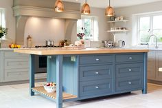 MODERN FARMHOUSE SUBTLE BLEND THE BRIEF Client was specific that they would like a Shaker style kitchen with a central island looking more like a farmhouse table. This needed to be a family friendly practical country kitchen. Kitchen Mantle, Cosy Kitchen, Open Plan Kitchen, Country Kitchen, New Kitchen, Kitchen Decor, Kitchen Design, Kitchen Cabinets, Family Kitchen
