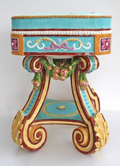 """Rubens"" Garden Seat with cheerful Rococo design by Wedgwood. Majolica International Society image from the Karmason Library."