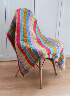 This blanket was designed by Julia Marsh of the popular blog, Hand Knitted Things, for the Stylecraft Blog Tour 2016 and uses seven colours of Special Chunky yarn. Knit and purl stitches are used throughout to create blocks of squares in bands of colourful stripes. This fun blanket will make a great splash of colour in your home and it knits up quickly on 6mm needles. We've also created a kit to go with this pattern where you can purchase the digital pattern and all of the yarn to create ...